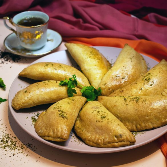 Middle Eastern Cheese Pastries on pink plate with tea cup