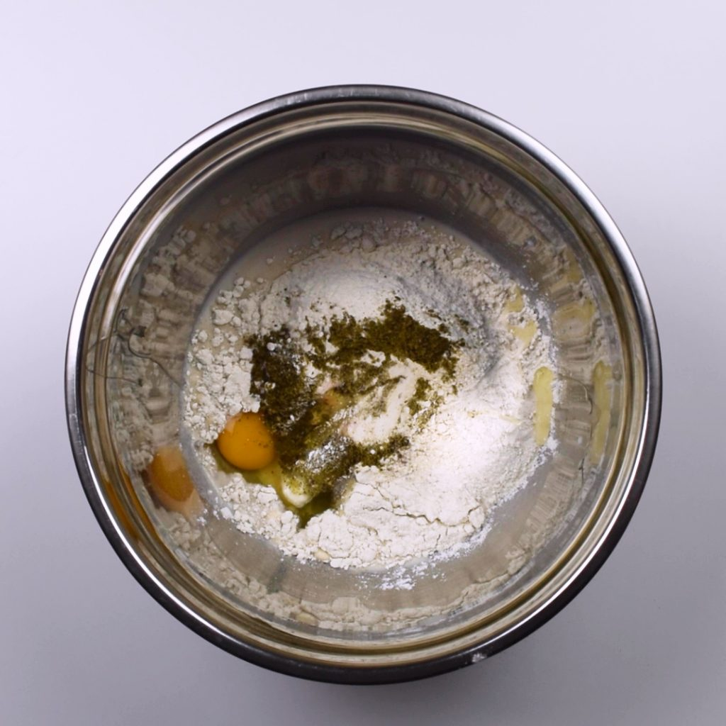 Dry ingredients mixed with milk and yeast mixture