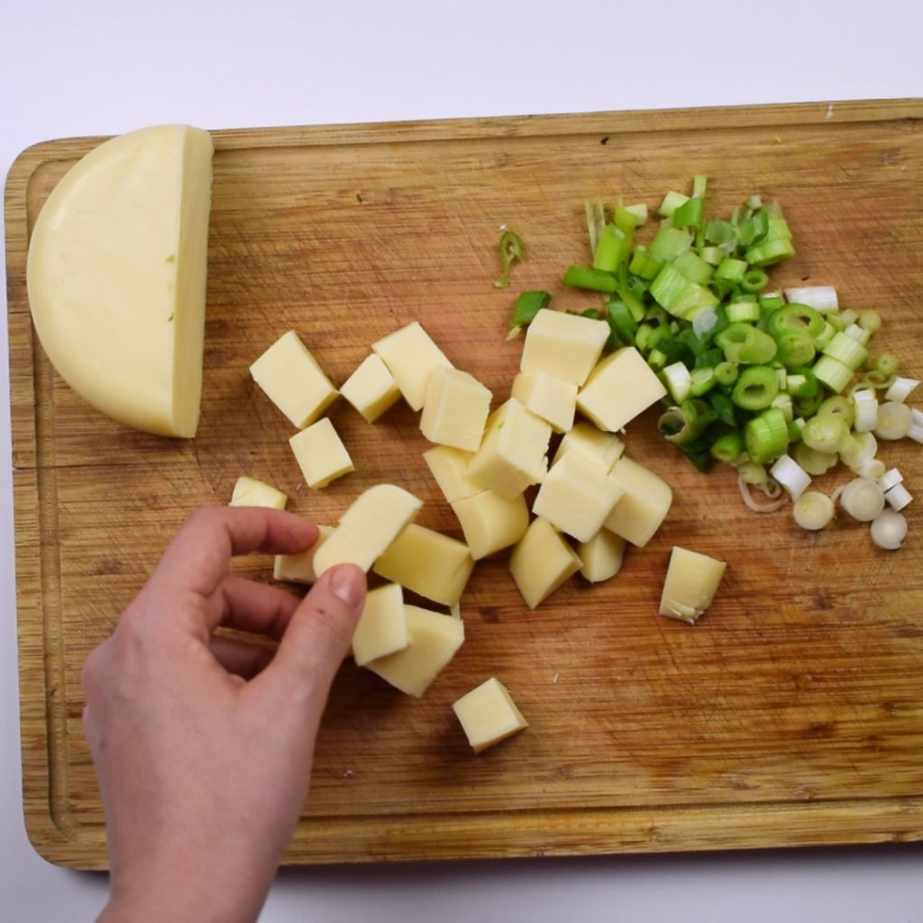 Cubes cheese and finely chopped spring onion