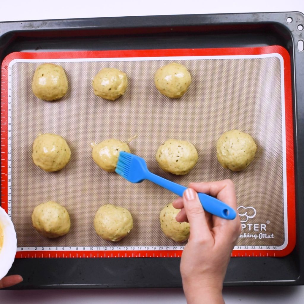 Brush cheese buns with egg wash