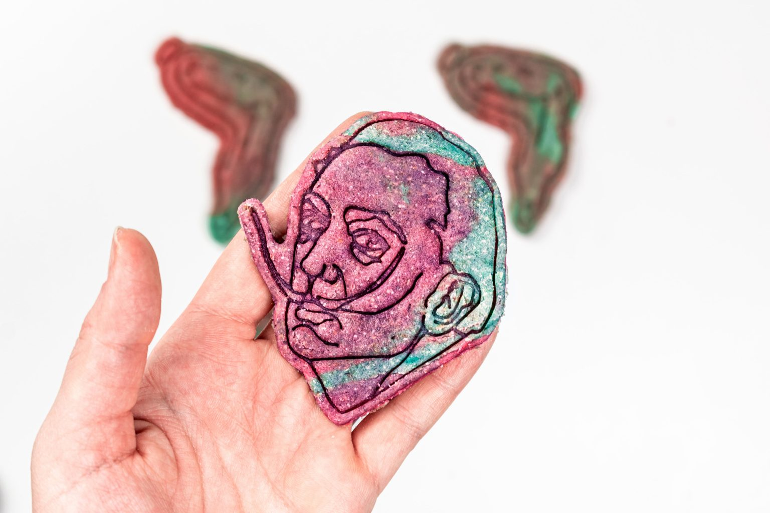 Hand with rainbow marble cookie Salvador Dali cookie cutter