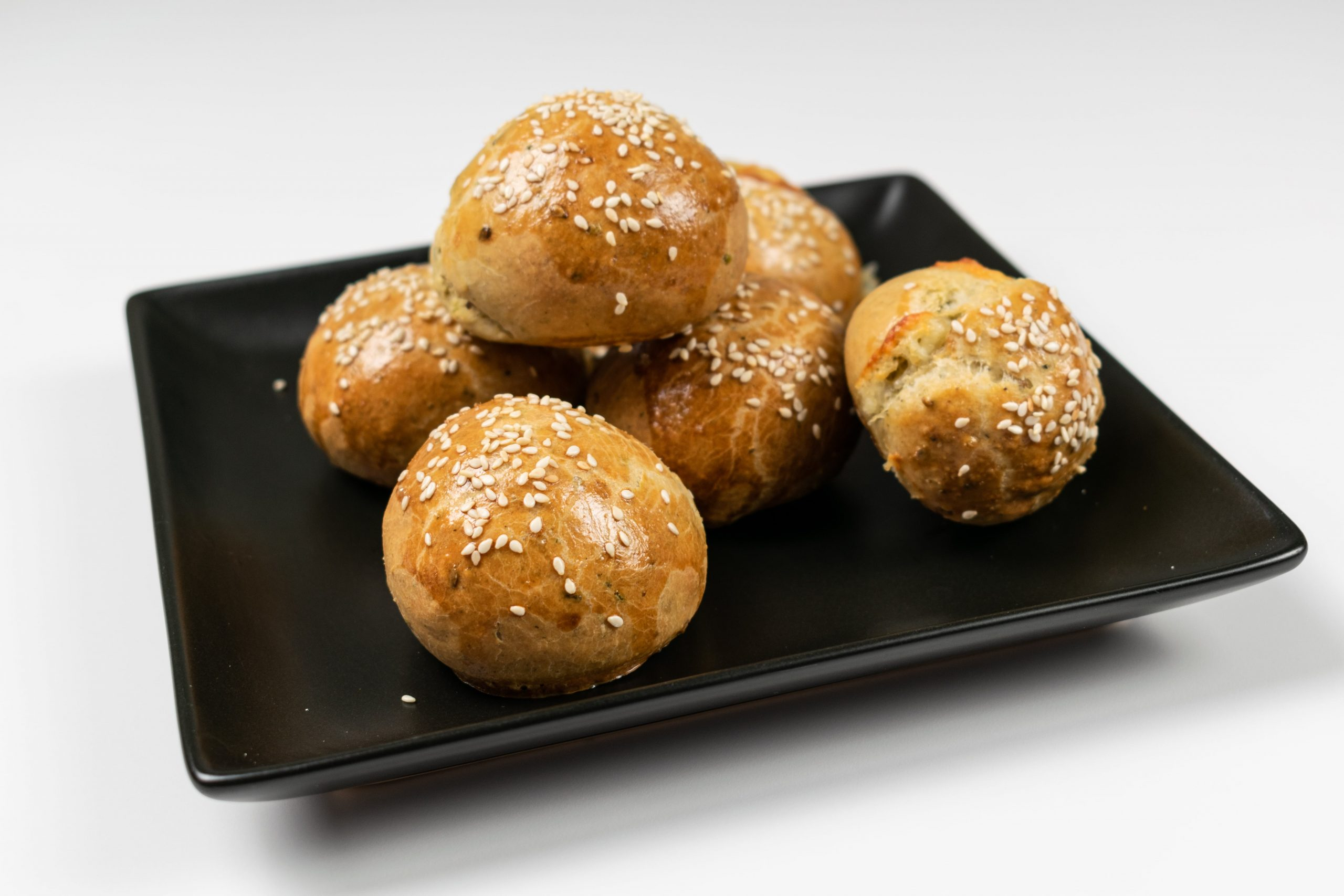 Cheese buns on black plate