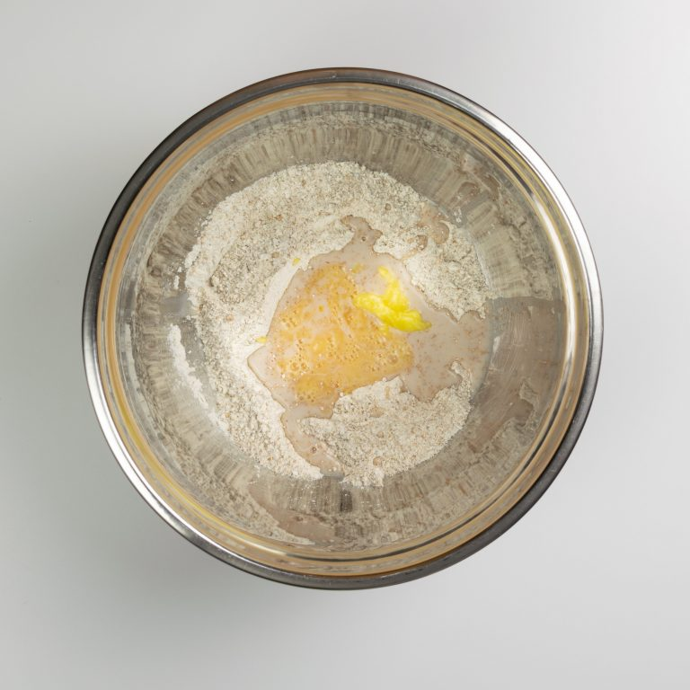 Flour and wet ingredients combined in large bowl