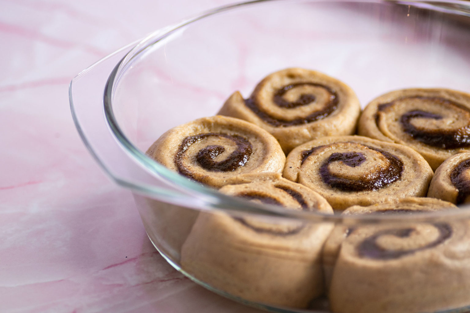 Uncooked cinnamon rolls in tray