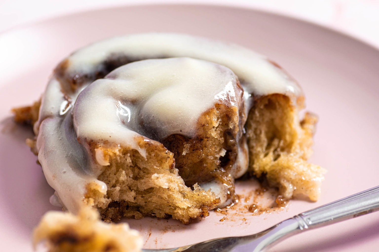 Close-up of cinnamon roll with cream cheese frosting