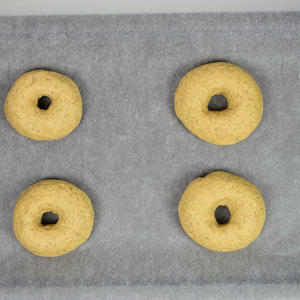 Four bagels on tray