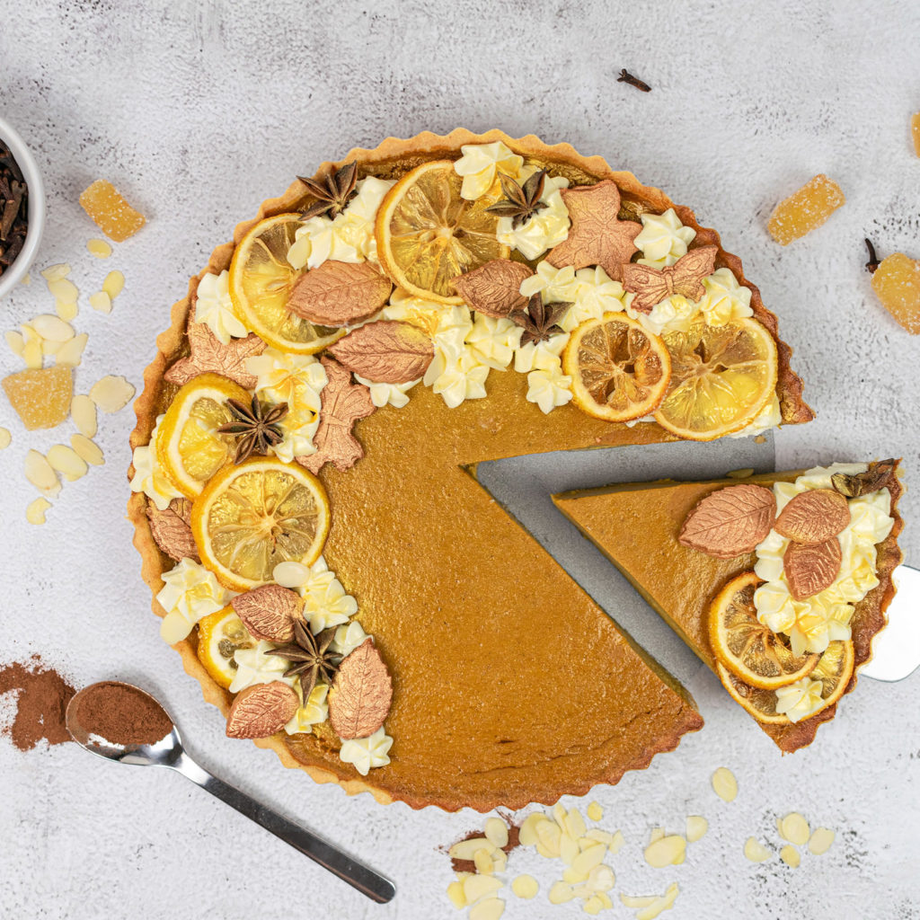 Spiced pumpkin pie with slice cut out