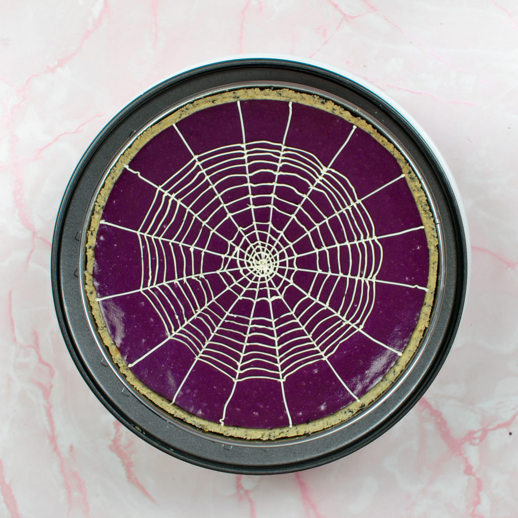 Flatlay view of tart with spiderweb piped on