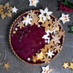 Creme brulee tart with mulled wine flatlay