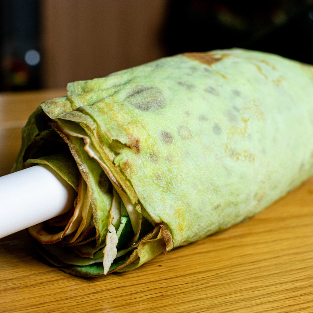 Crepes layered on rolling pin
