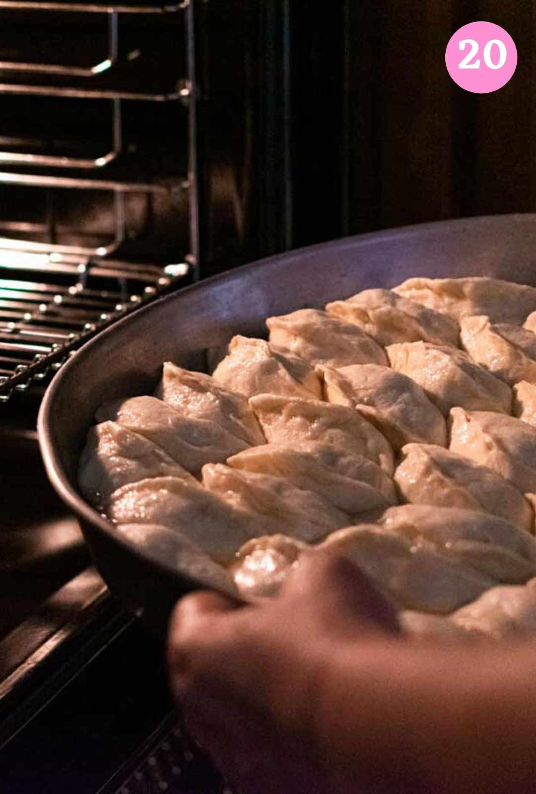 Placing hand pies in oven to bake