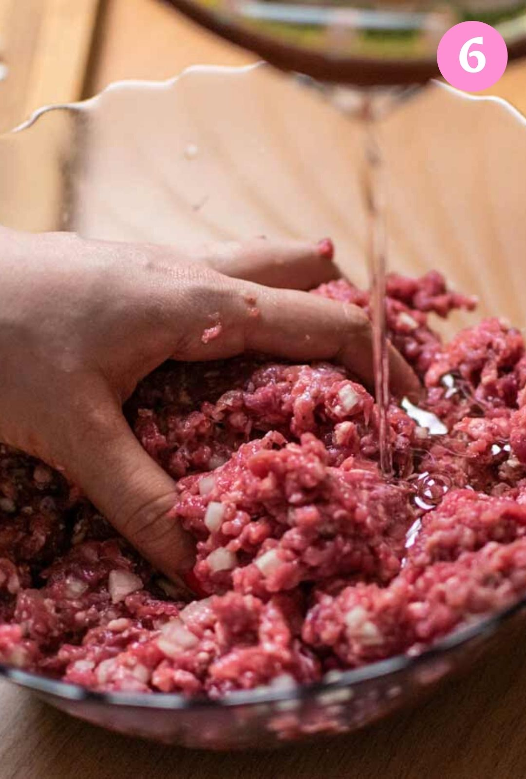 Mixing the ground beef with vegetable oil and spices