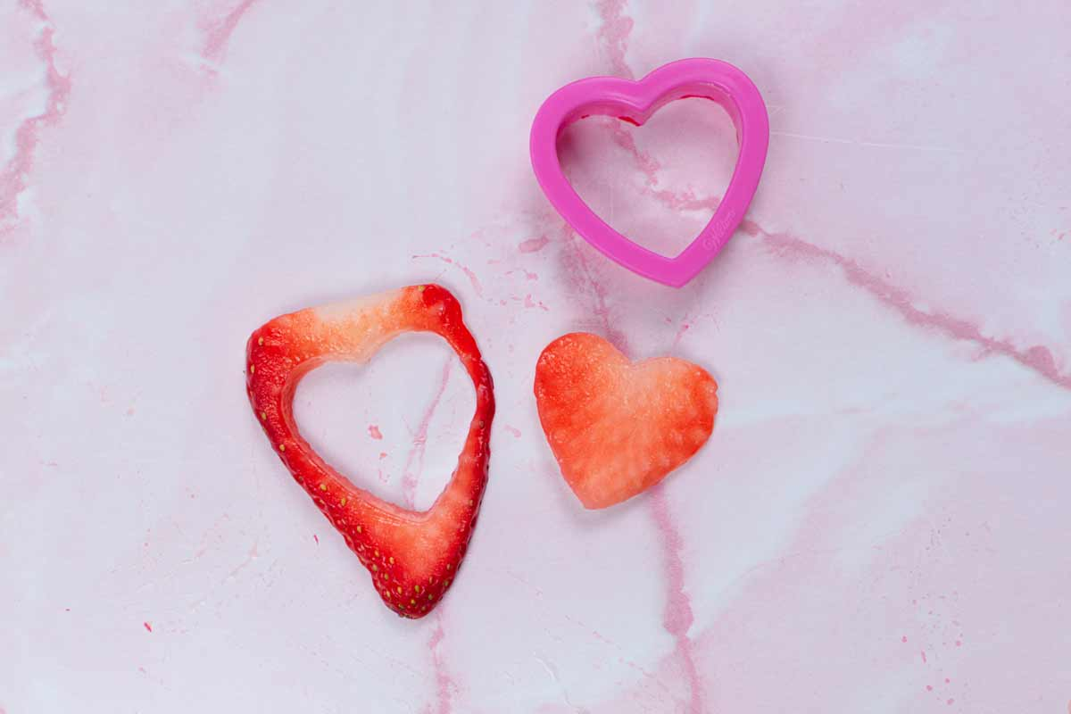 Strawberry hearts cut out using cookie cutter