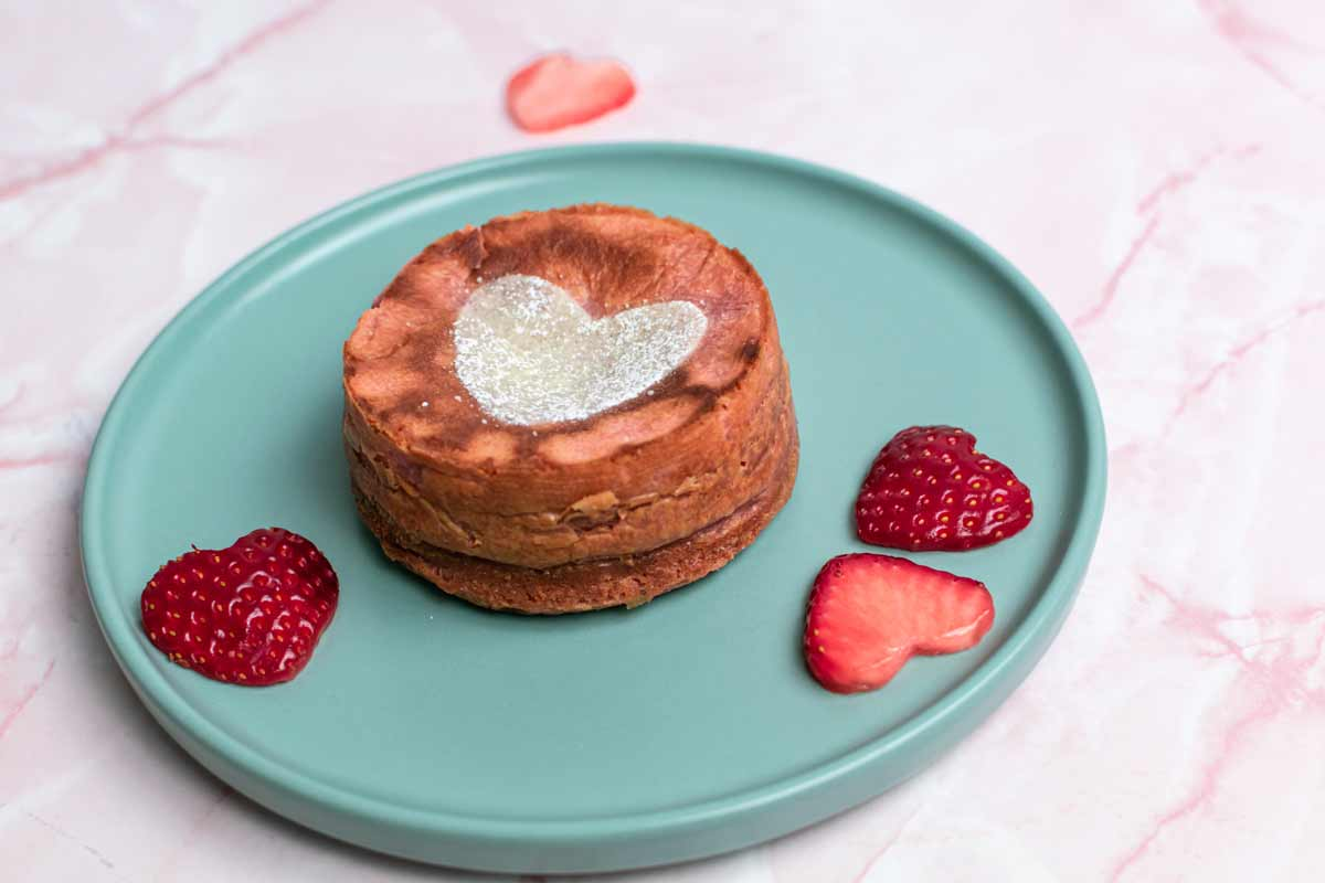 Round lava cake with heart decoration on plate