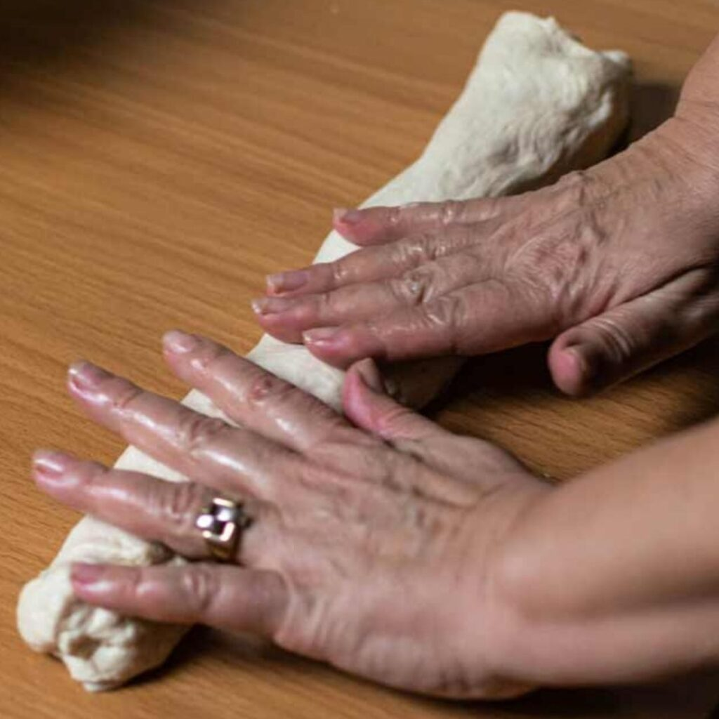 Rolling out dough with hands