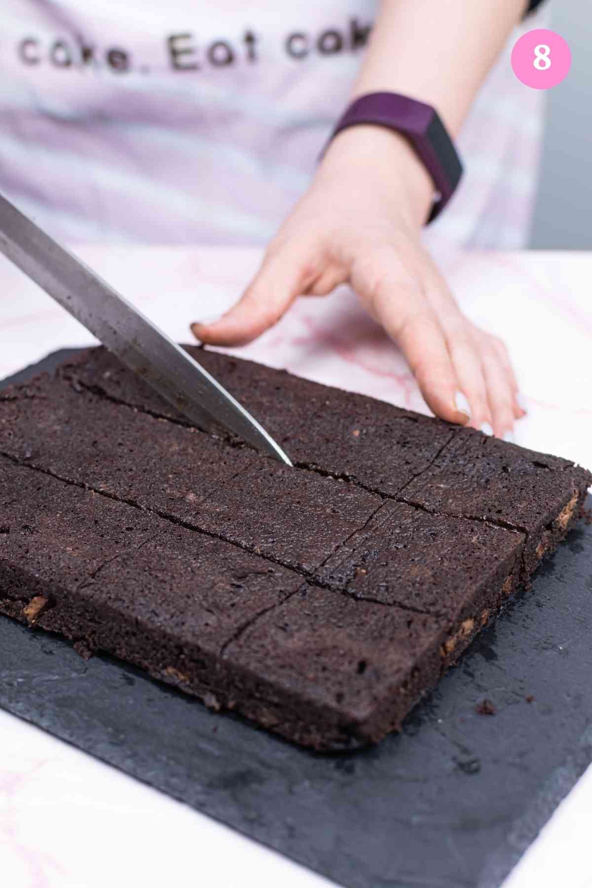 Step 8 - Baked brownies being cut with knife
