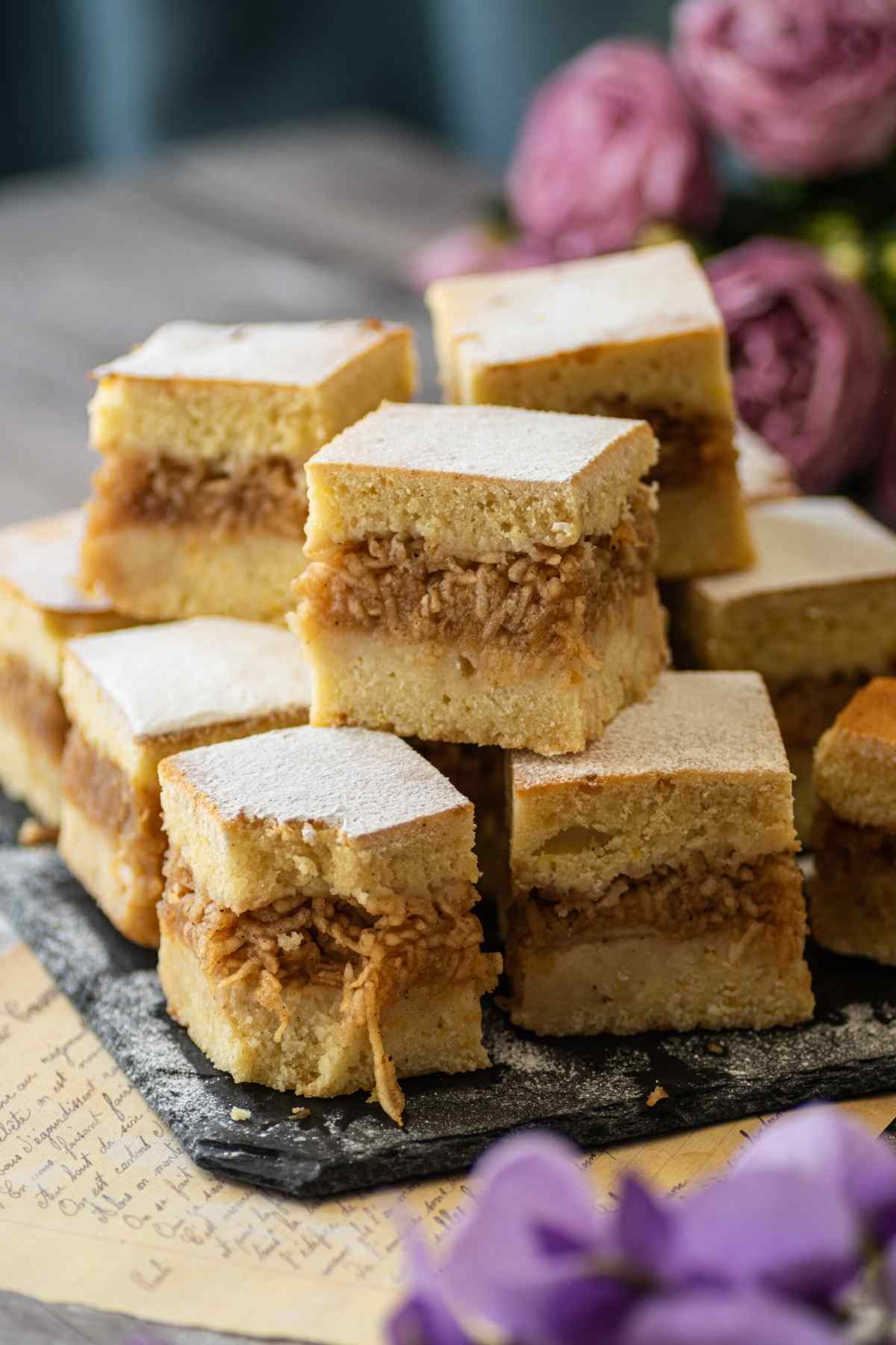 Slices of apple cake traybake stacked on top of each other