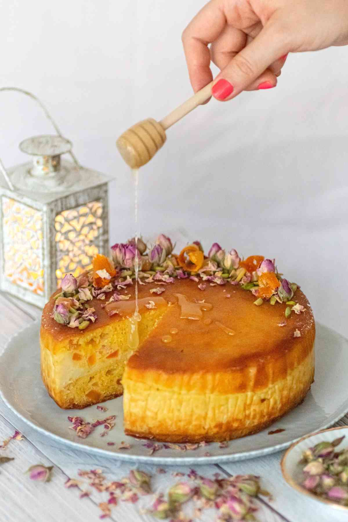 Drizzling honey over basbousa with cream