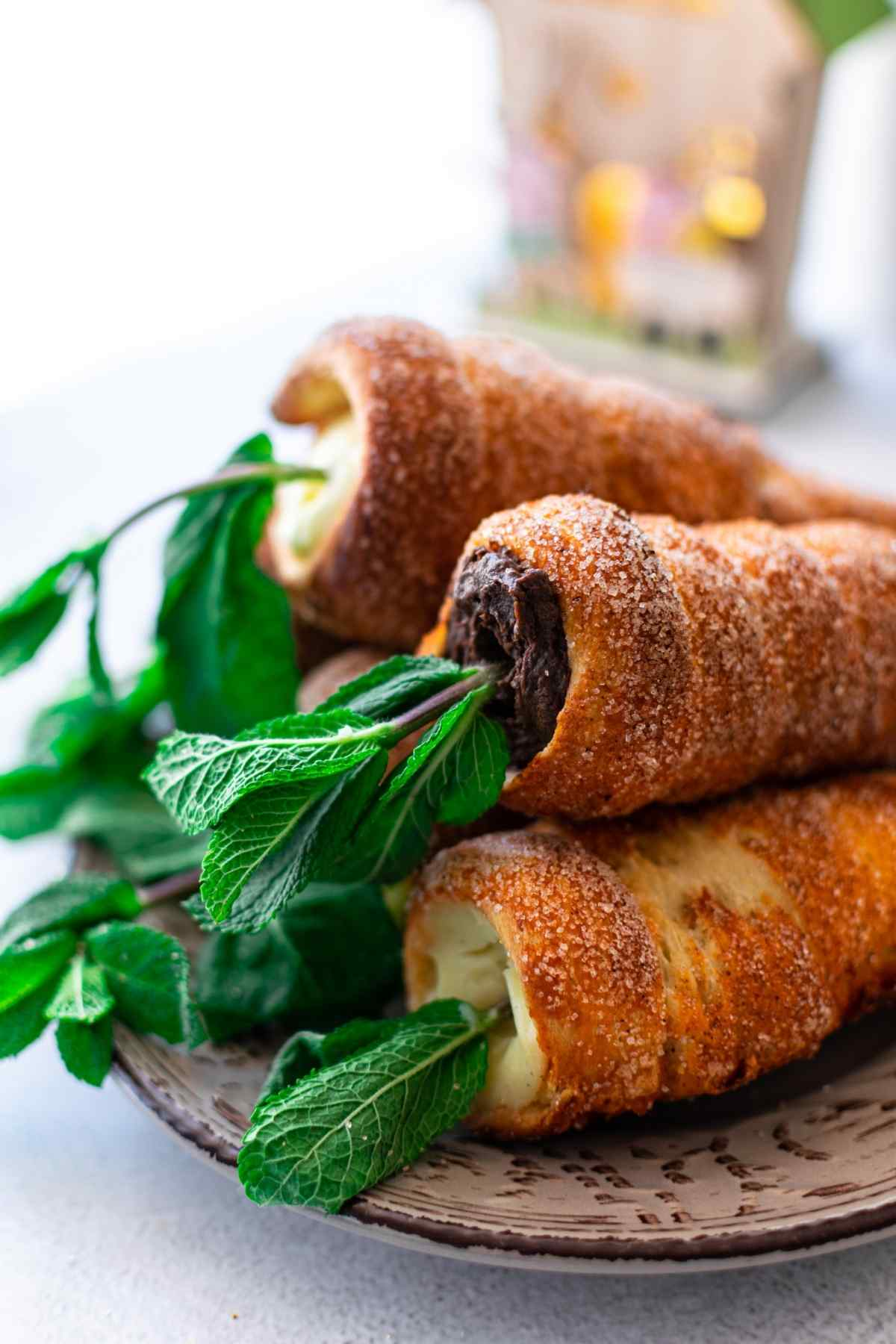 Stack of chimney cone carrot with mint leaves