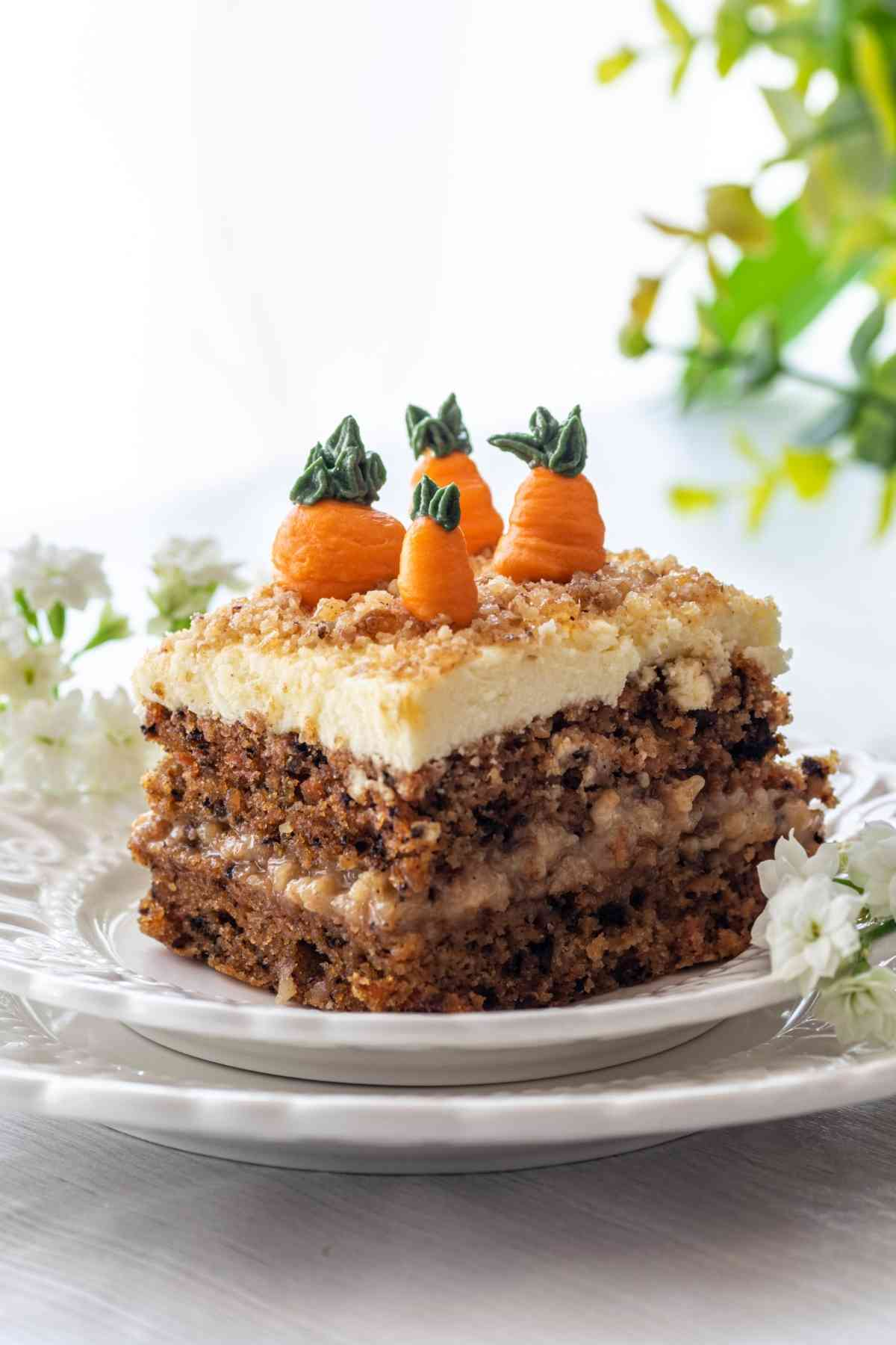 Closeup image of double layer carrot cake decorated with cream cheese carrots