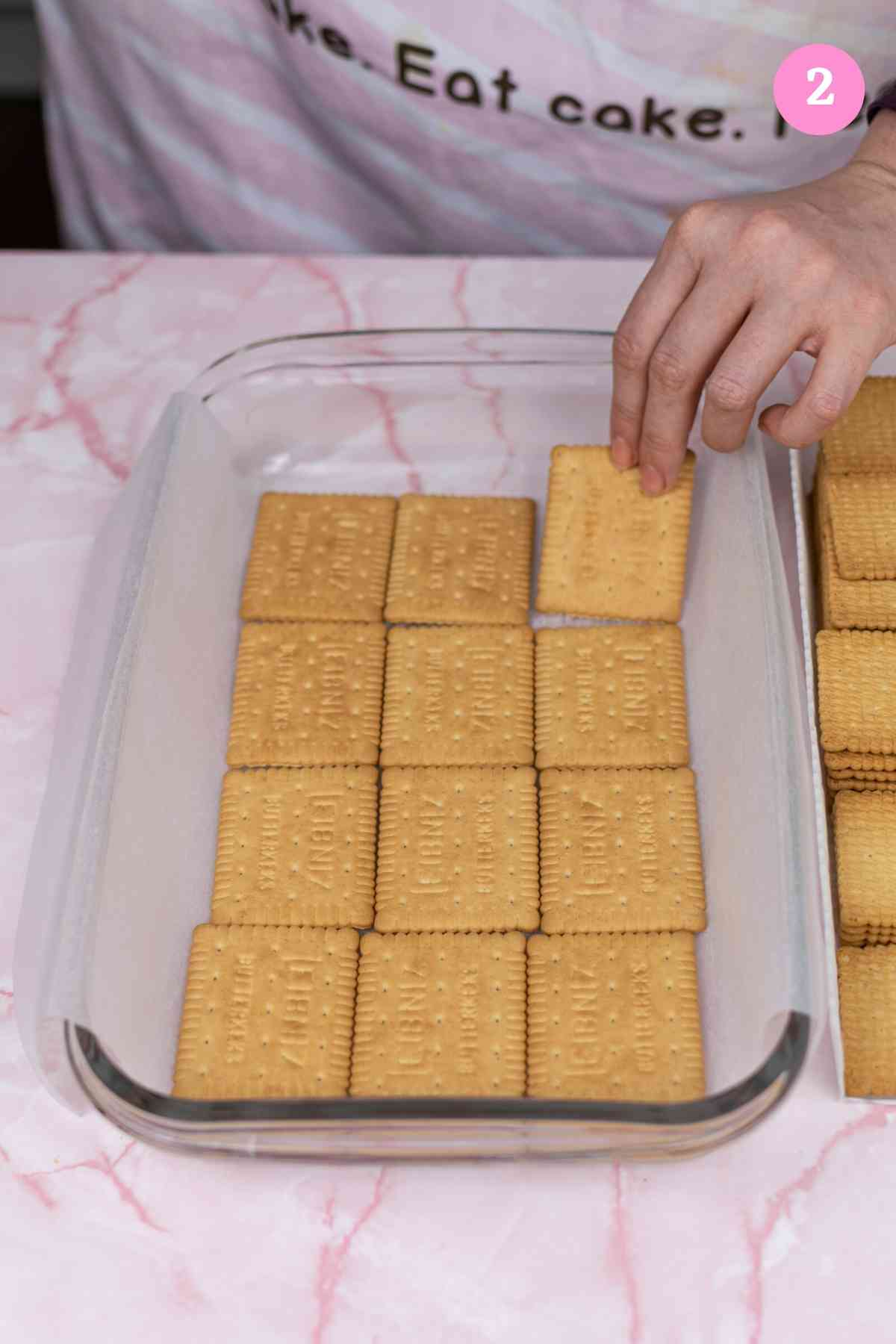 Placing bottom layer of biscuits in tray