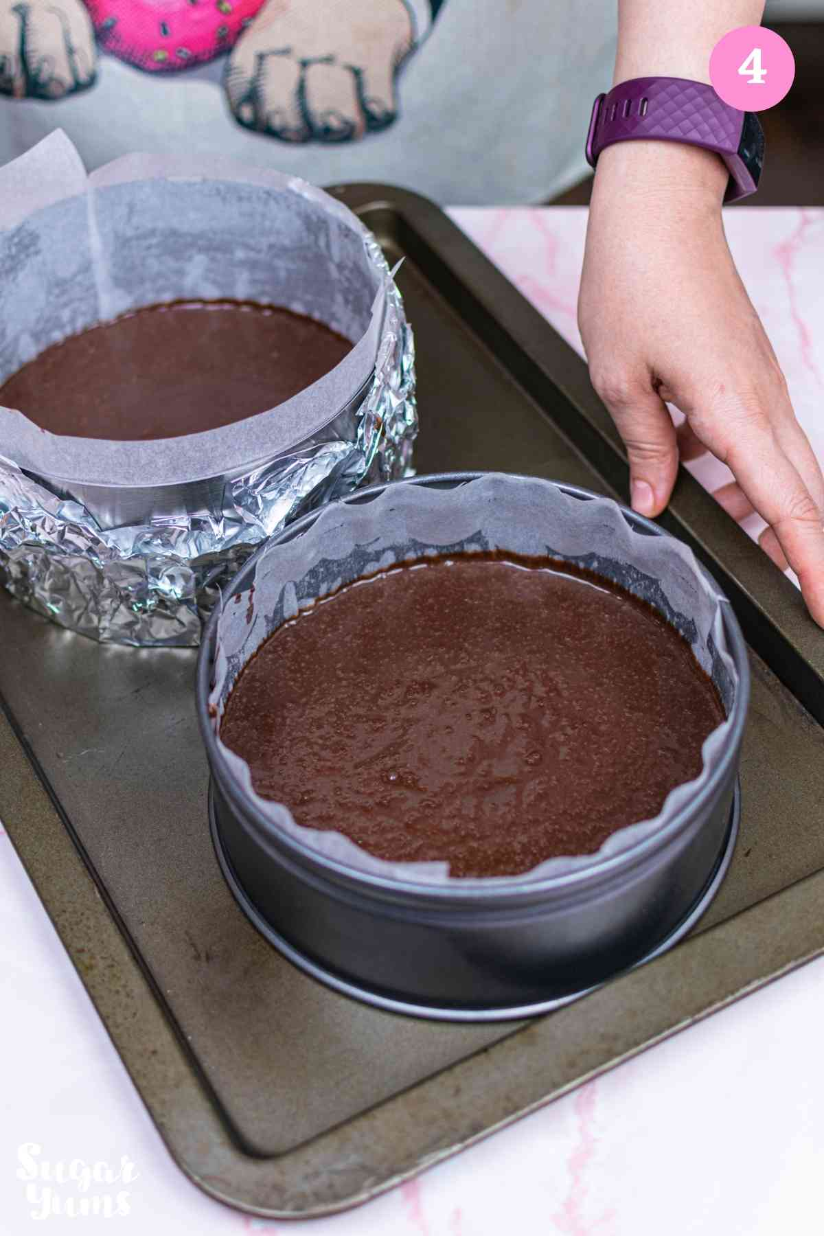 Batter inside two round cake pans
