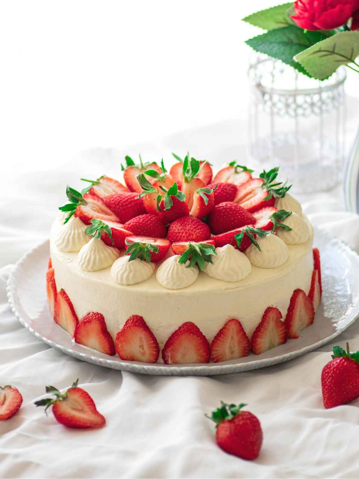 Japanese Strawberry Shortcake decorated with strawberries placed on white background