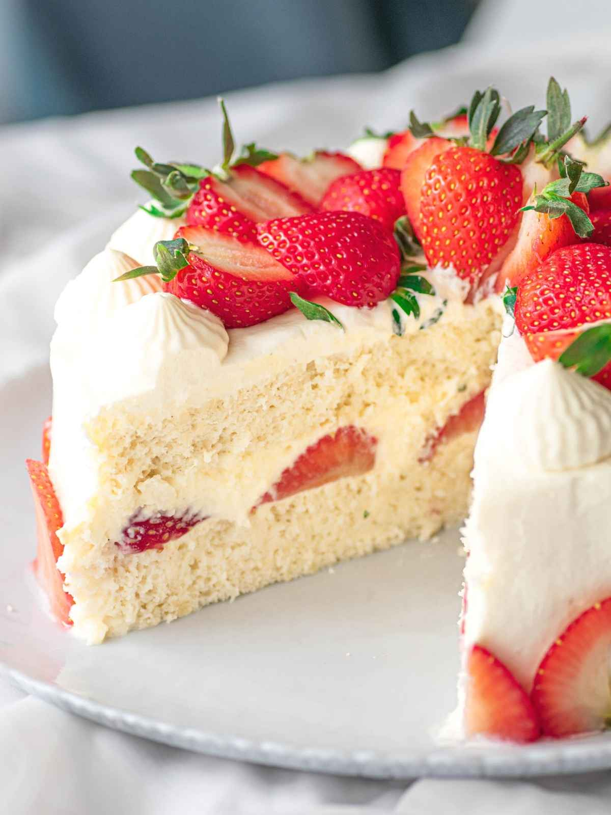 Strawberry shortcake with slice cut out showing inside layers