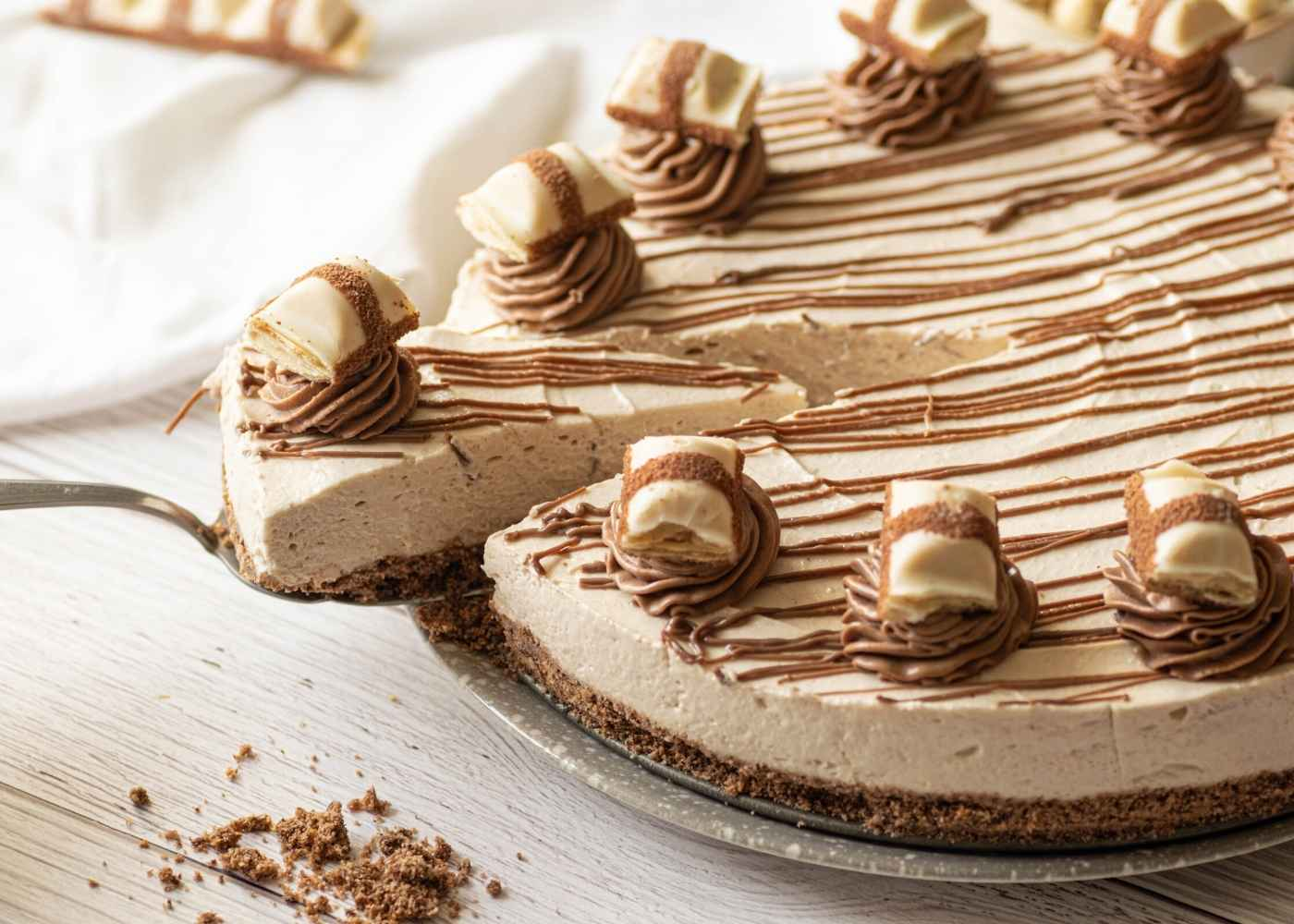 Kinder Bueno cheesecake with slice cut out