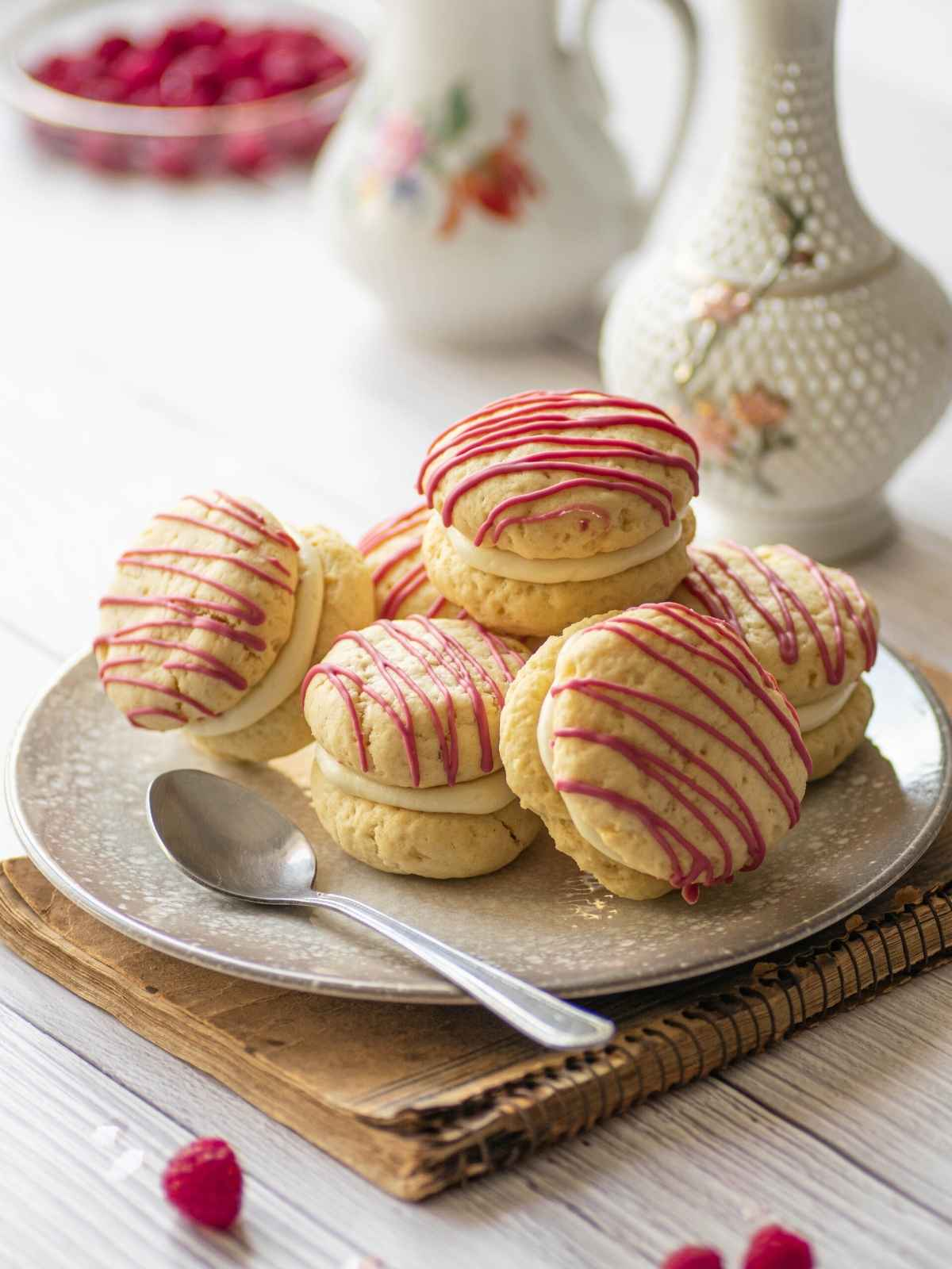 Raspberry cheesecake cookies stacked on top of each other
