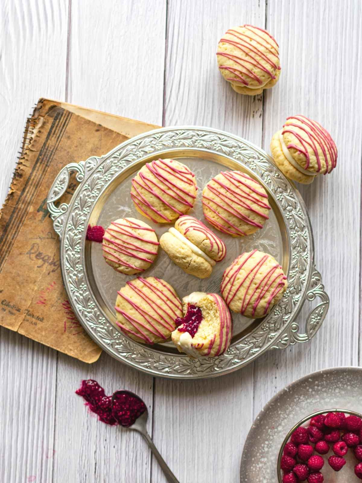 Flatlay image of raspberry cheesecake cookies on silver tray