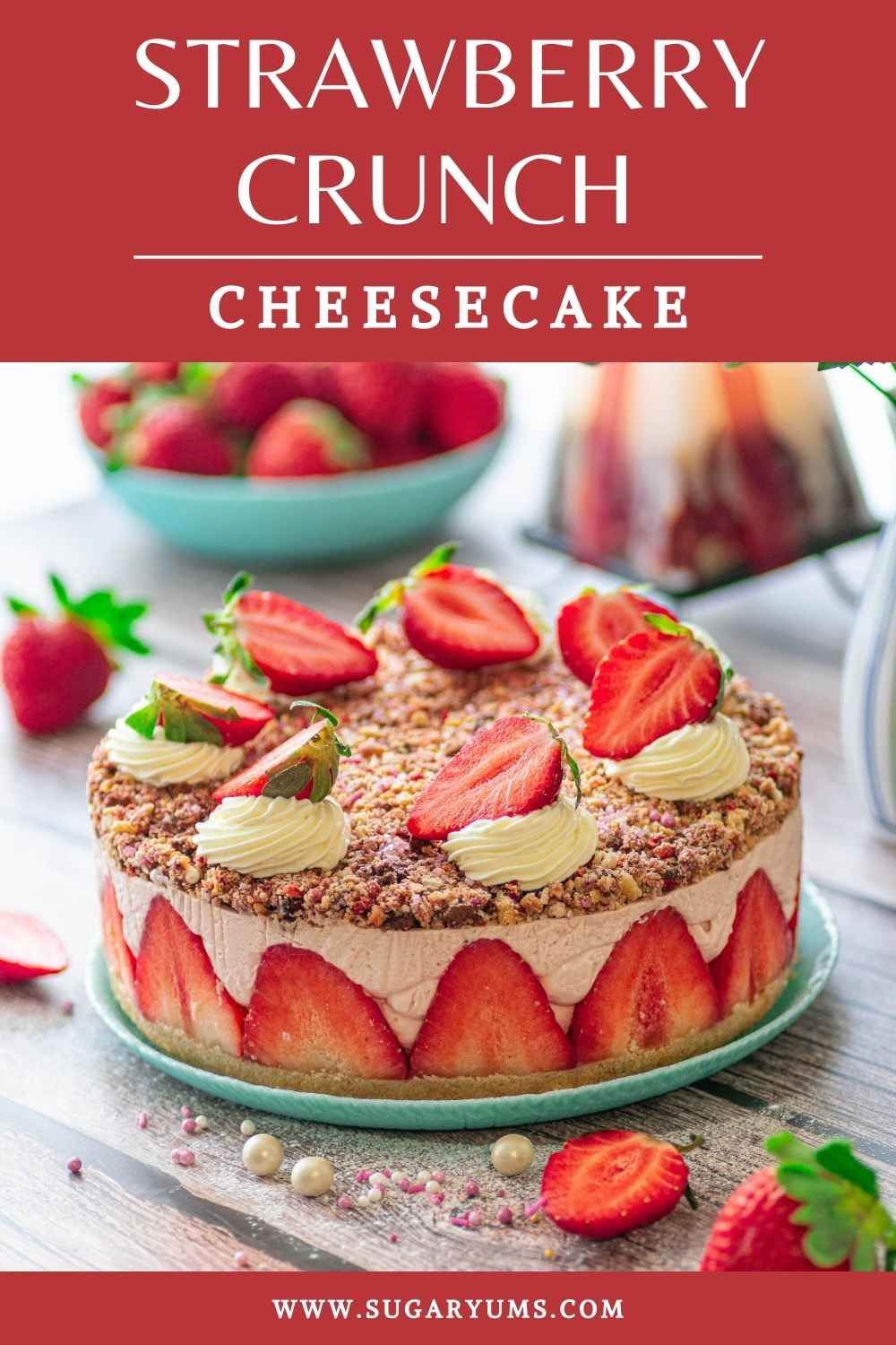 Strawberry crunch cheesecake cake on plate with writing on top