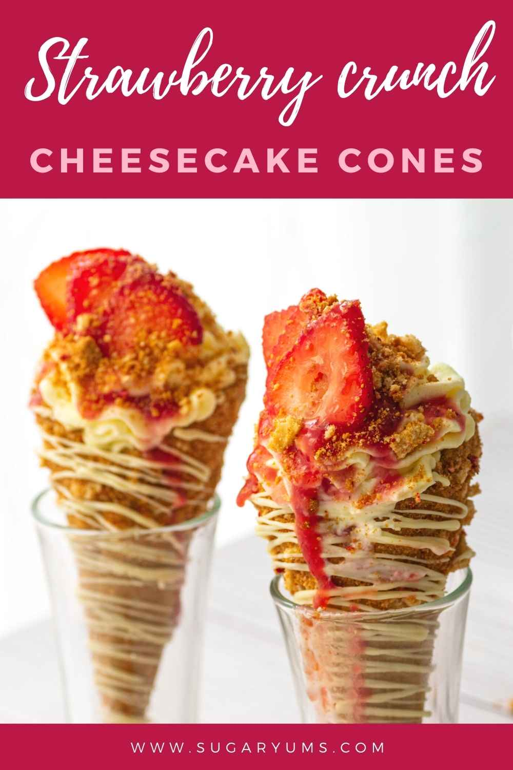 Closeup of two cones of strawberry cheesecake cones with writing on top